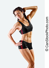 muscular athletic young slim woman on a light background. fitness