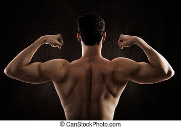 Muscular back of a man fitness posing