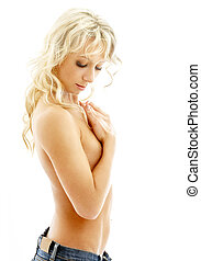 muscular blond in blue jeans over white
