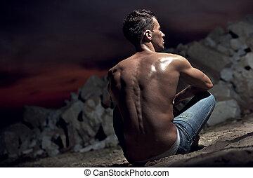 Muscular body of an handsome bodybuilder