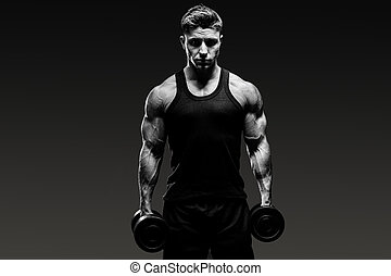 muscular bodybuilder guy  monochrome over grey background