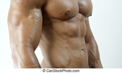 Muscular bodybuilder man shirtless in studio