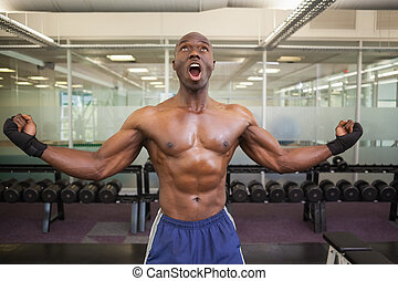Muscular boxer shouting in health c