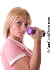 muscular build - Beautiful blond woman with dumbbell.