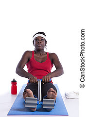 Muscular build dedication - young african woman doing some ...