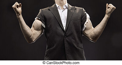 Muscular businessman achieving a life success - Muscular...