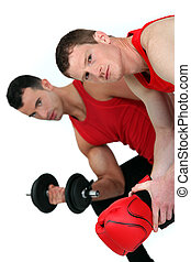 muscular fellow lifting weight and guy with boxing gloves