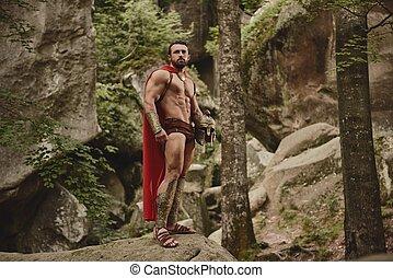 Muscular gladiator in armor