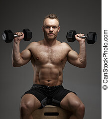 Muscular guy with dumbell