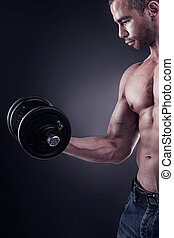 Muscular handsome man working out.