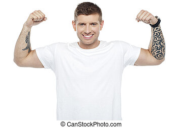 Muscular handsome young man showing his biceps