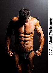 muscular, hombre, cuerpo, en, estudio, luz