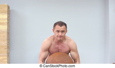Muscular male crossfit training. Slow motion. A athlete train in the gym