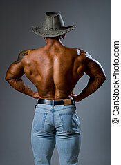 Muscular male in a hat .