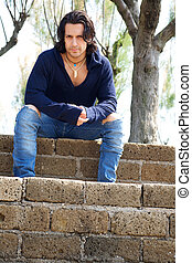 Muscular male model on stairs with sweat shirt