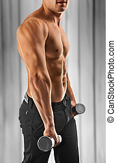muscular male torso on abstract background