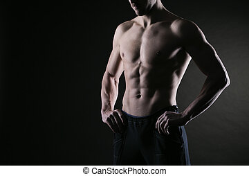 Muscular male torso - Sexy muscular man on dark background