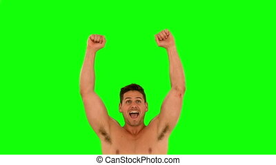 Muscular man cheering and jumping in slow motion