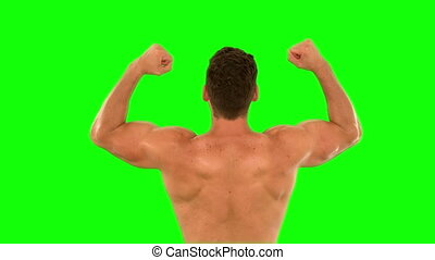 Muscular man cheering and jumping