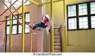 Muscular Man Climbs Rope