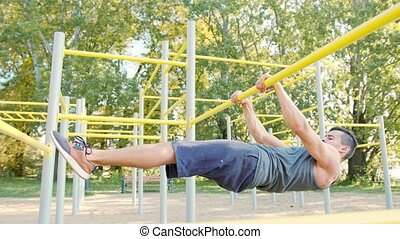 Muscular Man Doing Exercises on Horizontal Bar - Handsome...