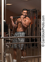 Muscular Man Doing Heavy Weight Exercise For Biceps