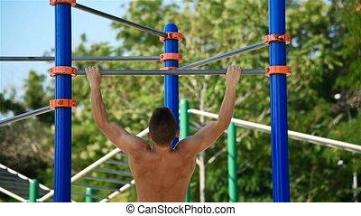 Muscular Man Doing Pull Ups