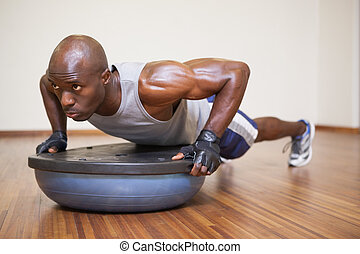 Muscular man doing push ups in gym - Full length of a ...