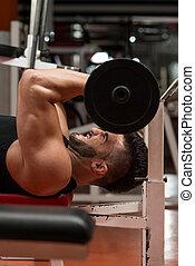 Muscular Man Exercising Triceps