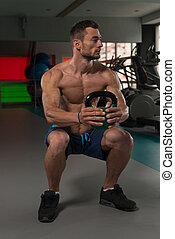Muscular Man Exercising With Kettle-bell