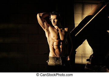 Muscular man in shadow