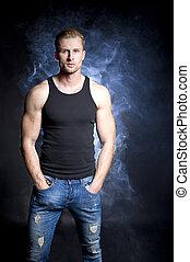 Muscular man in smoke