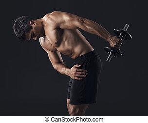 Muscular man lifting weights - Portrait of a muscular man...