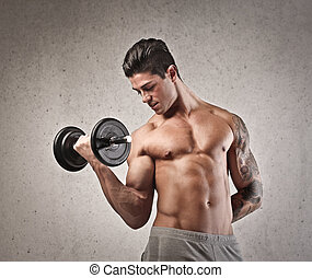 muscular man makes exercises on gray background