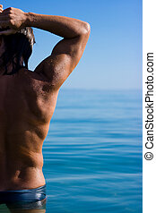 Muscular man - Muscular handsome man relaxing in the sea