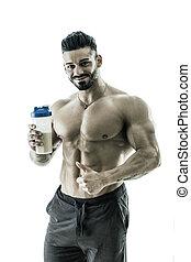 Muscular man posing with shaker