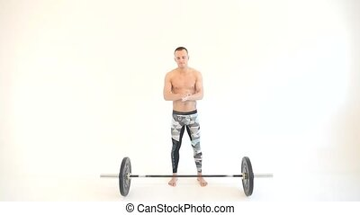 Muscular Man Preparing and Lifting Weights