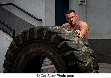 Muscular Man Resting After Tire Flip