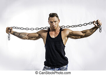 Muscular man shirtless with heavy, big metal chain