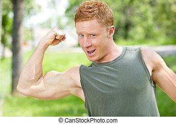 Muscular man showing his biceps