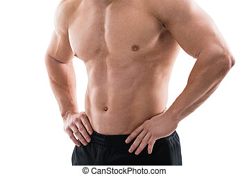 Muscular Man Standing With Hands On Hip