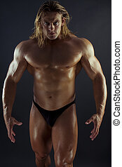Muscular man - Athletic sexy male body builder with the...