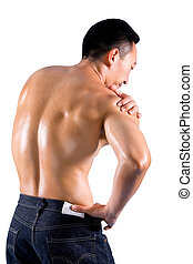 Muscular man suffering from pain on shoulder