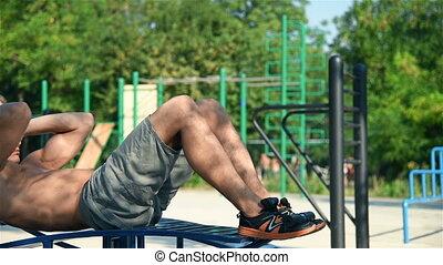 Muscular Man Swinging Press