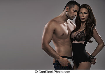 Muscular man touching his alluring wife