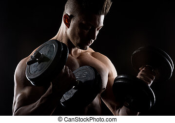 Muscular man weightlifting - Muscular attractive man...