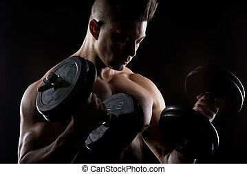 Muscular man weightlifting - Muscular attractive man...
