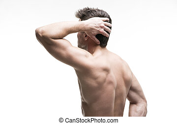Muscular man with a headache isolated on white background