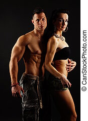 Muscular man with his girl