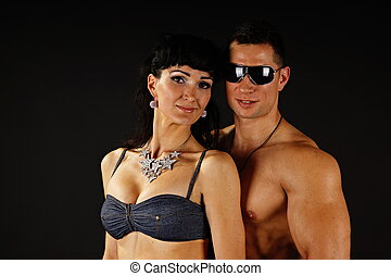 Muscular man with his girlfriend